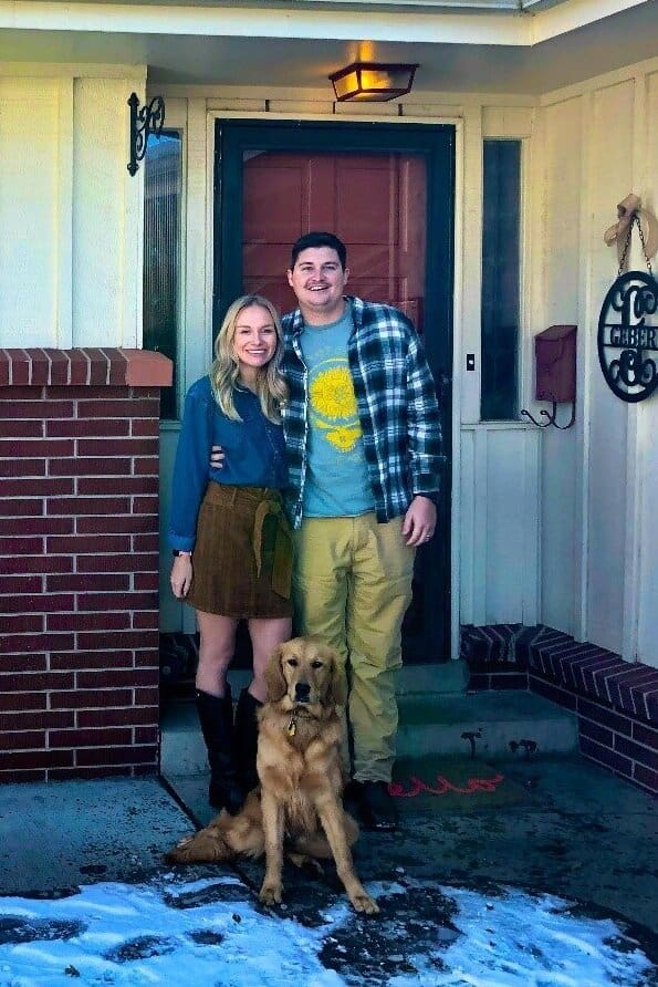 PHOTO: The author (Lauren), her husband Carson, and Sugaree, their golden retriever, outside their home. Credit: Eric Johnson